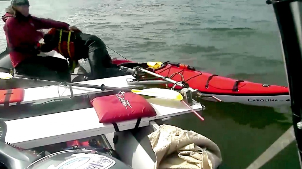 Hayley Shephard pulls a kayaker from the frigid waters