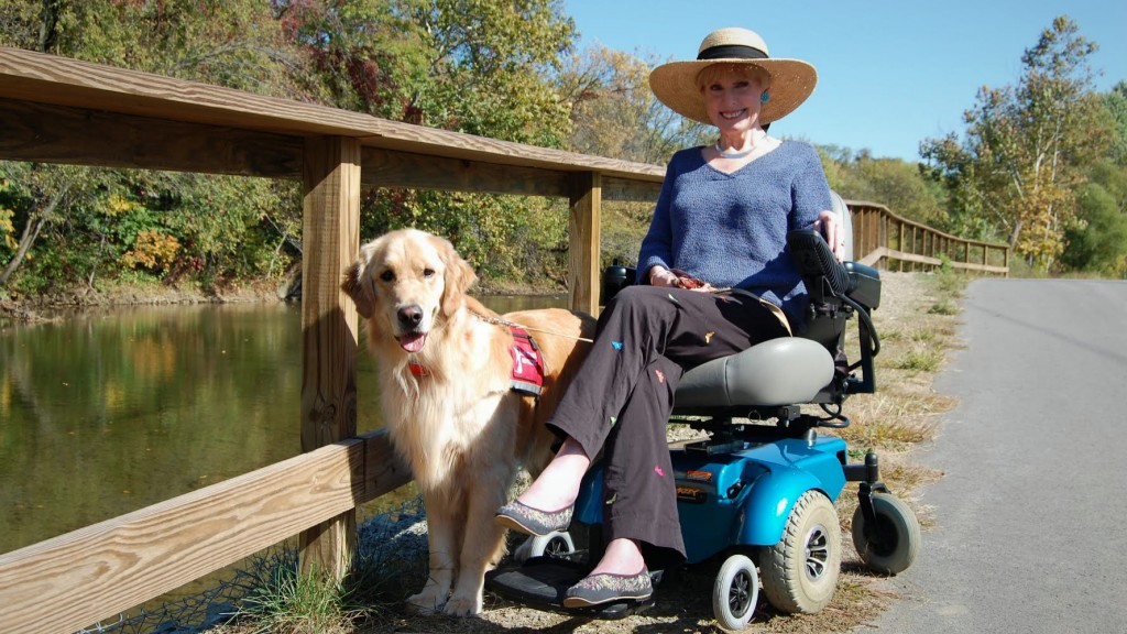 Saint Francis co-founder Carol Willoughby with her Saint Francis service dog, Midas