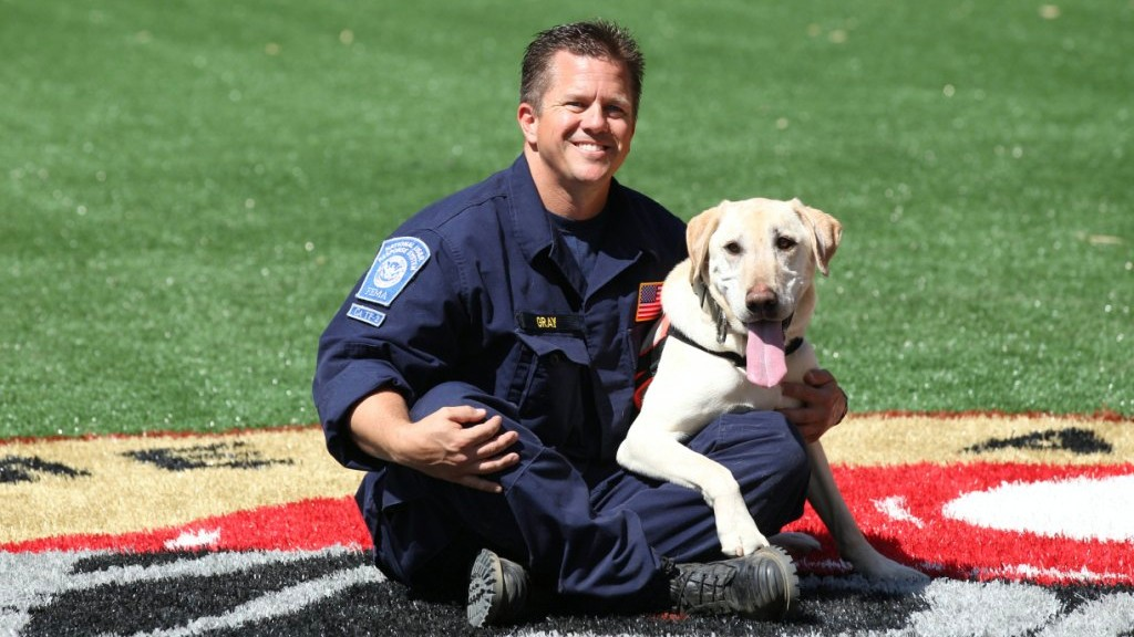 Eric Gray and Riley of Search Dog Foundation