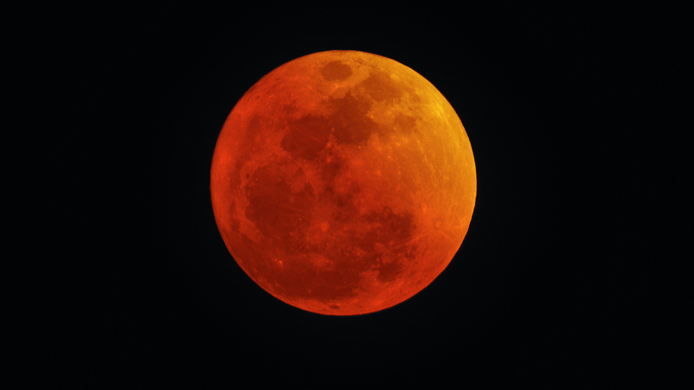 The reddish hue of a lunar eclipse