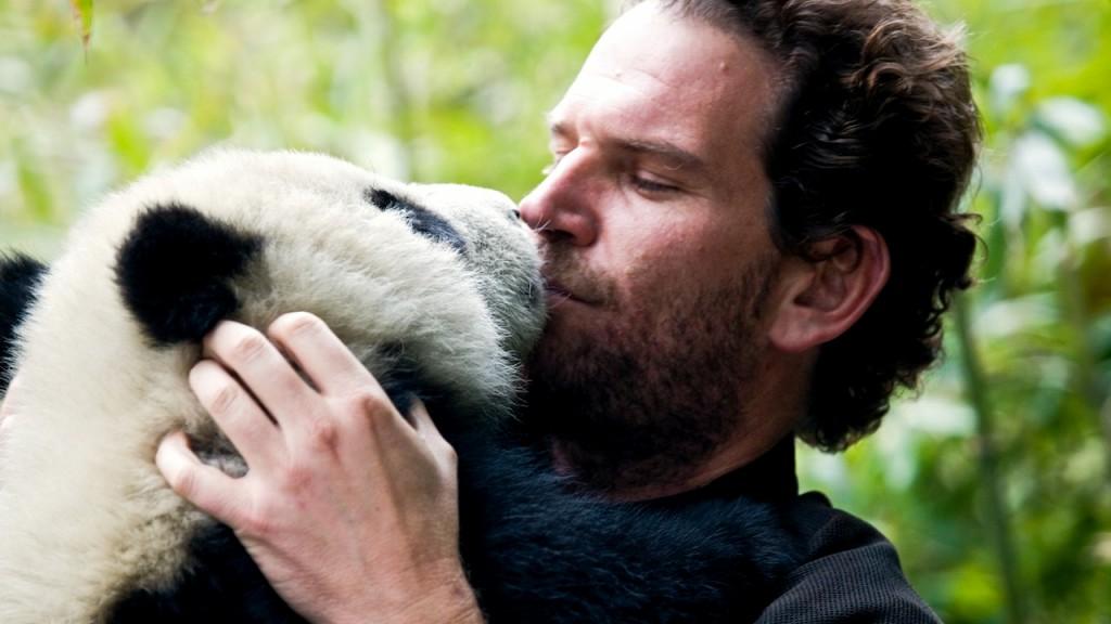 Charlie Annenberg hugs a panda
