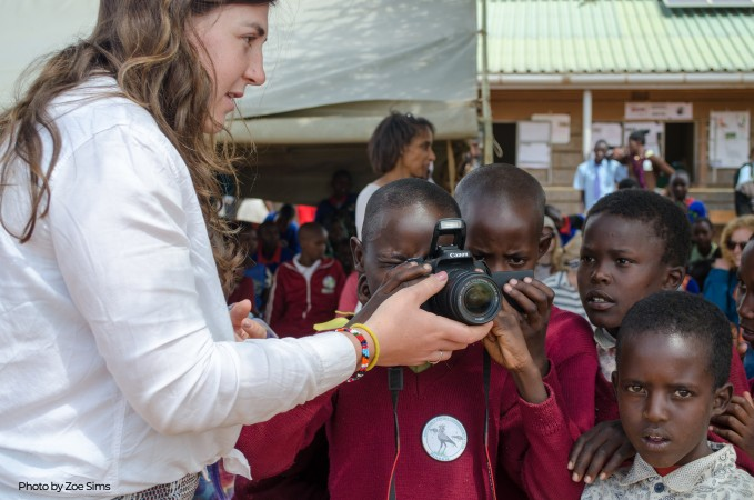 Capturing the moments. Ciara Nutter, Princeton in Africa Fellow at Mpala has some fun showing pupils how to use a camera