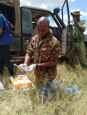 Dr. Mutinda prepares his treatment kit. Photo by Victor Kasii